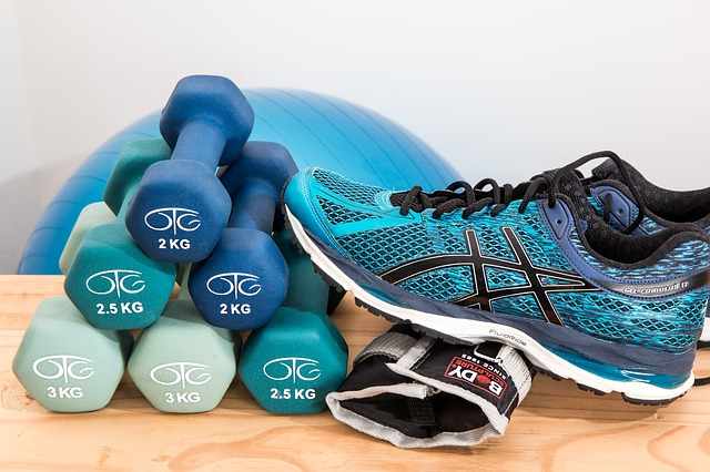 photo of dumbbells and tennis shoe.
